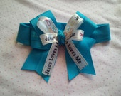 Turquoise headband with turquoise ribbon and JESUS loves me