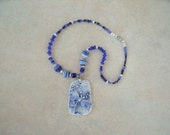 Handmade porcelain dragonfly pendant with beautiful cobalt blue glaze. Necklace made of accent blue glass beads. Clasp is magnetic.