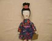 Cloth Doll with Blue Flowered Dress