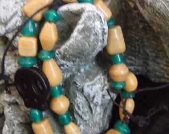 Unisex Beaded green and ivory bracelet set with black skull bead