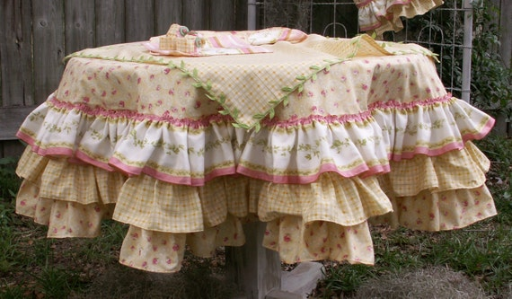 Shabby Chic Tea Party Table Set Up with Round Tablecloth and Napkins