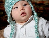 Soft Crocheted Baby Blue Beanie With Ear Flaps and Tassles
