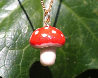 Going spotty for toadstools - tiny polymer clay pendant with gold bail 2