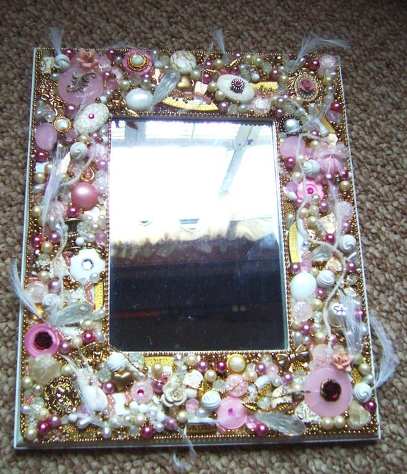 Beautiful Mosaic Mirror made with Vintage jewelry and bits and pieces. Pinks with white
