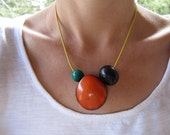 grainy orange tagua seed pendant, yellow greek leather cord, wood beads