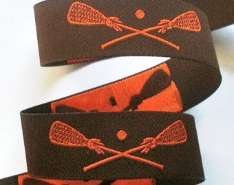 ORANGE LACROSSE on Brown Jacquard Ribbon - 1""