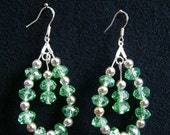 Swarovski crystals teardrop earrings and  925  sterling  silver  hooks and silver plated  post