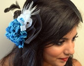 Statement Making Blue and  Black Feather Fascinator