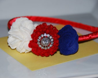 Red, White and Blue Felt Flower Headband on top of a Red Satin Ribbon Wrapped Plastic Headband with Bling Center