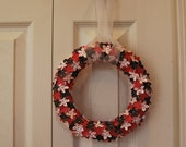 Hydrangea paper wreath in solid red, grey with white polka dots, and white with red polka dots