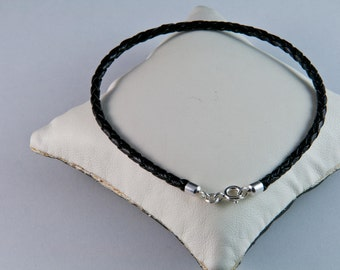 Round plaited leather bracelet with silver ends SOLD