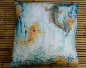 """Cotton and Japanese silk cushion pillow. """"Leaping Koi"""" design furoshiki handmade with recycled ikat meisen silk back. 50x50cm, 20x20ins."""