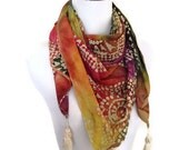 Bright tie dye bohemian style summer triangle scarf with ivory tassels. Light summer accessory.