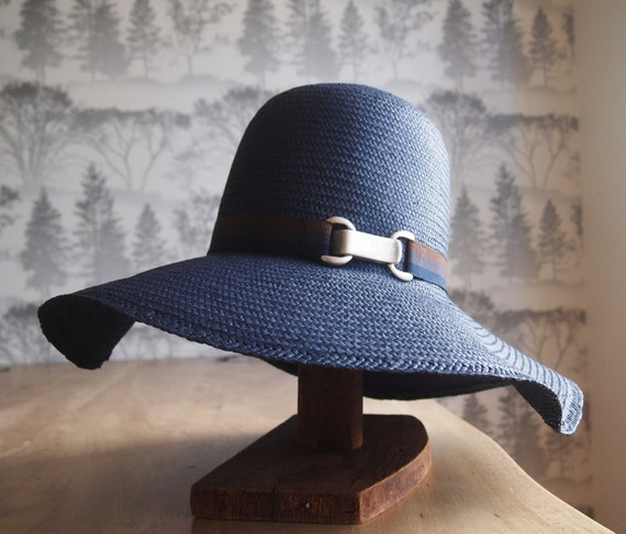 Elegant and simple slouchy sun hat in navy with brown, smoke, navy trim and distressed silver metal closure