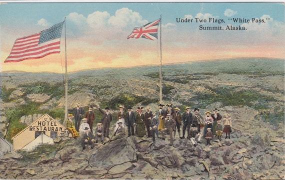 "SUMMIT, ALASKA Under Two Flags, ""White Pass,"" Summit, Alaska, Vintage Postcard, Lowman and Hanford Co., 1900s"