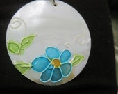 painted shell with flower necklace