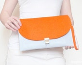 White and orange felt clutch
