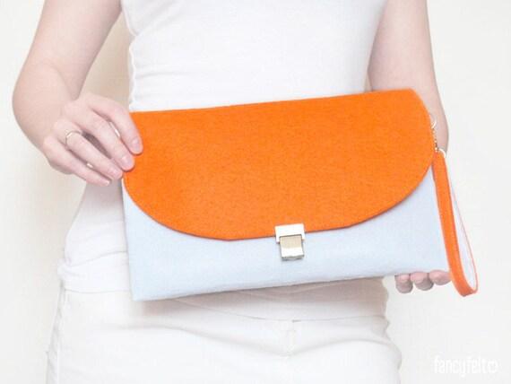 White and orange felt clutch