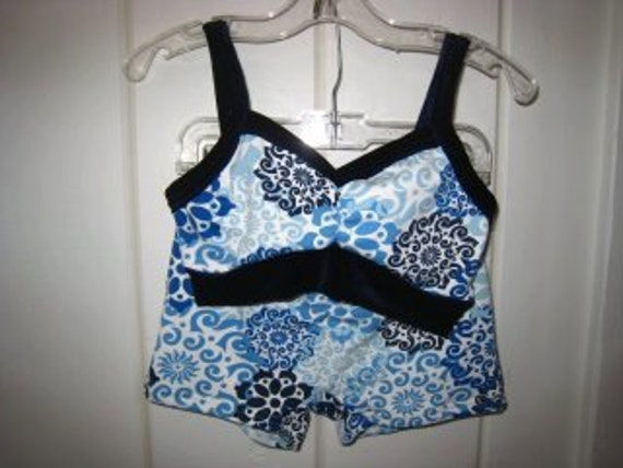 Blues and white with navy blue velvet trim on bra top and booty shorts