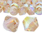 Pack of 50 Swarovski 5328 4mm Bicones in Crystal AB Golden Shadow (sku 7843 - 5328-4-CR-AB-gsh)