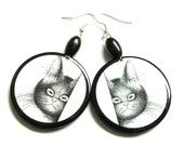 CAT earrings. Graphics on both sides. Effect of glass, black and white, round, very light.