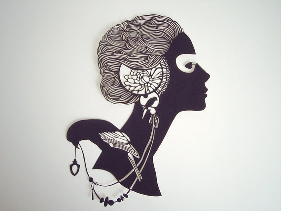 Girl with a bird - hand-cut paper silhouette - 9,5 x 6,3 inches