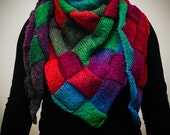 Beautiful, gradient and colourful knitted triangular scarf.