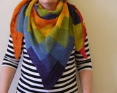 Knitted triangular scarf in vibrant rainbow colours