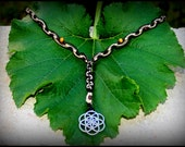 Hemp Macrame Necklace with Flower of life silver metal pendant.