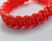Paracord anklet in orange with metal rings
