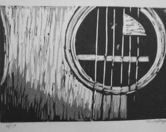 Single-block reduction linocut print guitar grayscale 1