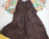 Adorable Girls 0-3 month baby dress in Brown fabric with contrasting sleeves and ruffle