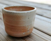 Altered, flashing orange and white Anagama fired tea bowl, holds 10 oz.