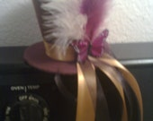 brown butterfly feather mini top hat.