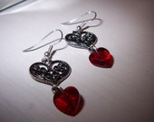 Sparkling Swarovski crystal earrings made with heart shaped siam crystals