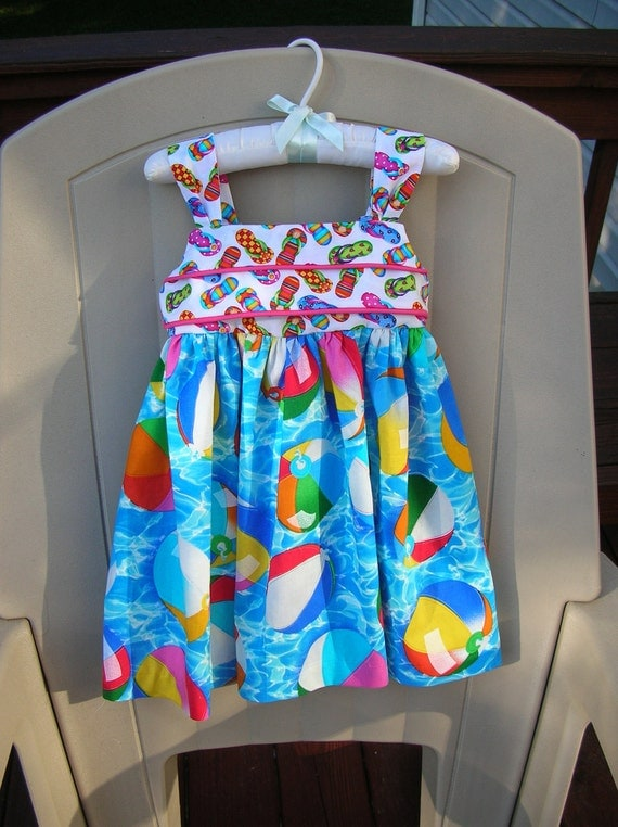 Beach dress, size 2T, 2 toddler sundress with beach ball fabric and flip flop fabric, piping, bow tie, fabric covered buttons.