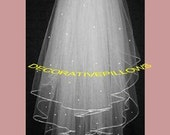 IVORY BRIDAL VEIL. 3  tier elbow length  with pencil edge and crystals scattered over  the 3 tiers. great for Ivory wedding dress