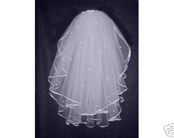 white 2 tier bridal veil with perals and rhinestone  Ready to wear with comb attached.