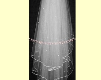 IVORY  BRIDAL VEIL. 3  tier fingertip  length  with pecil edge and crystals scattered over  the 3 tiers.