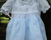 Baby's blue dress and petticoat