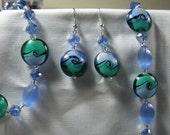 Teal green, black and blue swirl earrings