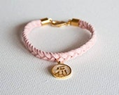 Braided light pink suede bracelet with gold plated Allah swt enamel pendant
