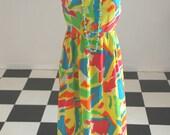 1960's long halter top sun dress with fun, splashy colors and ruffled hem, size 12