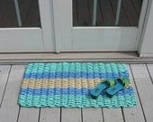 aqua blue and tan handwoven doormat from lobster trap rope.