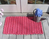 Nantucket red handwoven doormat from lobster trap rope.