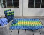 blue green and yellow handwoven doormat from lobster trap rope.