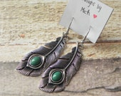 Silver feather earrings with green accents