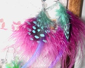 Feather earrings are so in right now. They go with every outfit..