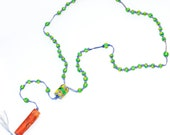 Fun summer vintage tribal necklace, green and yellow beads, blue cord