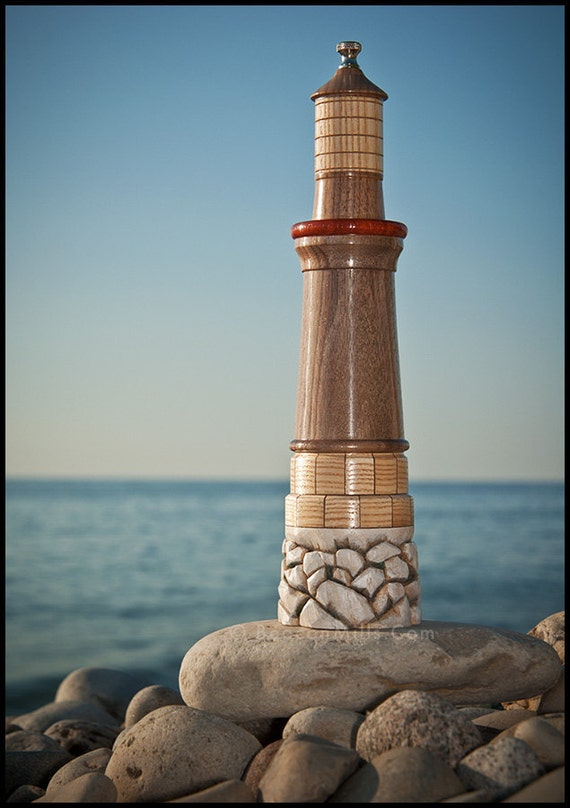 Lighthouse (Beacon) Pepper MIll in Black Walnut & Padauk atop Stone Block and Rubble Piling in American Ash